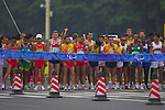Standing athletes await the start of the marathon at the Beijing Paralympic Games, Tianamen Square, Beijing.