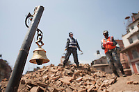 Nepali police force clears the rubble from a destroyed temple during the search operation at Kathmandu Durbar Square, Kathmandu, Nepal. May 03, 2015