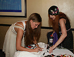 """OLTL's BethAnn Bonner """"Talia"""" signs for Jane Elissa at the One Life To Live Fan Club Luncheon on August 16, 2008 at the New York Marriott Marquis, New York, New York.  (Photo by Sue Coflin/Max Photos)"""