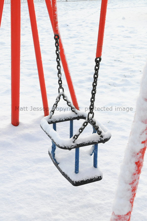 Snow covered swings
