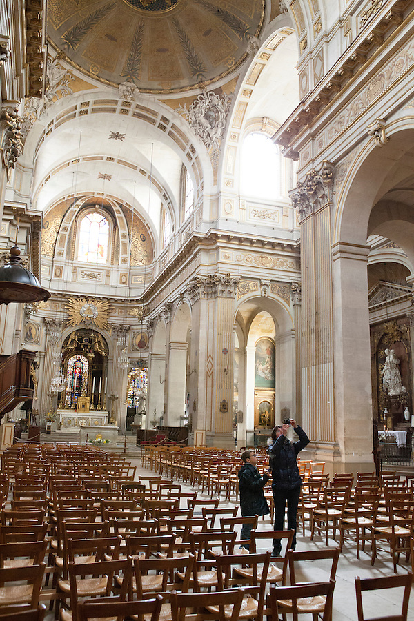 A mother and son take pictures in Saint Louis en L'Ile Church, Rue Saint-Louis en L'ile, Ile Saint-Louis, Paris, France, Europe