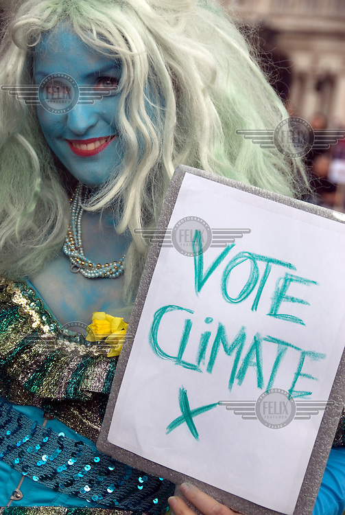 Lucy, a climate change campaigner, demonstrating on May Day in Parliament Square, Westminster, London, days before the general election.