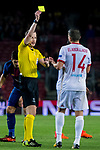 Referee William Collum shows Omar Elabdellaoui of Olympiacos FC the yellow card during the UEFA Champions League 2017-18 match between FC Barcelona and Olympiacos FC at Camp Nou on 18 October 2017 in Barcelona, Spain. Photo by Vicens Gimenez / Power Sport Images