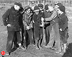children choose sides for a game of baseball during recess at Kingsbury School in Waterbury in March of 135.