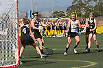 Santa Barbara, CA 02/18/12 - Kendra Keenan  (Cal Poly SLO #3) and Molly Carstensen (Colorado #14) in action during the 2012 Santa Barbara Shootout.  Colorado defeated Cal Poly SLO 8-7.