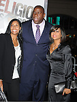 "HOLLYWOOD, CA. - January 11: Earvin ""Magic"" Johnson, Cookie Johnson and Taraji P. Henson attend the ""The Book Of Eli"" Los Angeles Premiere at Grauman's Chinese Theatre on January 11, 2010 in Hollywood, California."