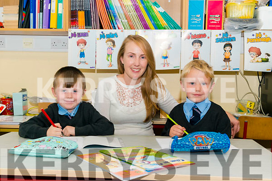 Class teacher Miriam Madigan with her new junior infants Micheal Foley and Ryan Fears on their first day of school in Meetogues NS last Friday.