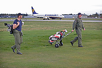 Systems operator Håvard Bakke and Flight Engineer Kurth Falldalen enjoy a game of golf between missions, and between a taxi way and the runway. Crew from Norwegian Air Force 330 squadron, flying Westland Sea King helicopter. The core mission of the squadron is SAR (search and rescue), but they also fly HEMS (Helicopter Emergency Medical Service), complementing the civilian air ambulance service.<br />