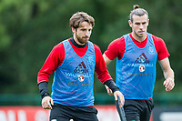Joe Allen is overseen by Gareth Bale during Wales national team training at Vale Resort, Hensol, Wales on 4 September 2017, ahead of the side's World Cup Qualification match against Moldova. Photo by Mark  Hawkins.