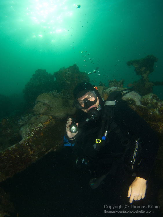 Apo Reef, Sulu Sea -- Diver preparing to enter Apo wreck.