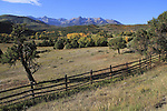 Fence and Sneffels Range with autumn colors near Telluride, Colorado, USA.
