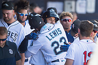 Peoria Javelinas shortstop Javier Guerra (70), of the San Diego Padres organization, receives a hug from Kyle Lewis (23), of the Seattle Mariners organization, after hitting a home run during a game against the Scottsdale Scorpions on October 19, 2017 at Peoria Stadium in Peoria, Arizona. The Scorpions defeated the Javelinas 13-7.  (Zachary Lucy/Four Seam Images)