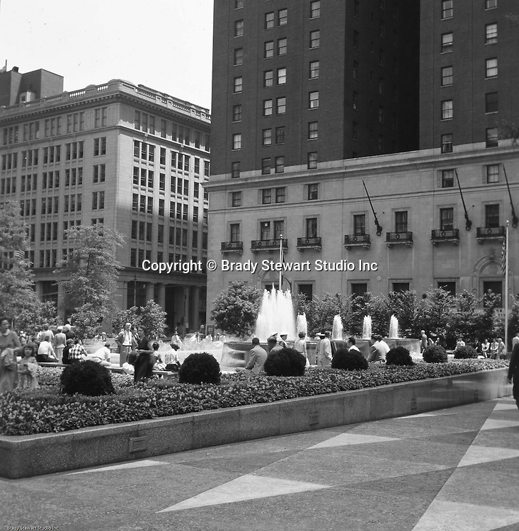 Pittsburgh PA:  View of Mellon Square Park in Pittsburgh - 1959.  Mellon Square, built in 1953-55 was designed by Mitchell & Ritchey, landscaped by Simonds & Simonds, and paid for by Mellon family foundations.  Rumor has it that the park was built to keep Alcoa Corporation from moving from Pittsburgh to New York City in the early 1950s.  Other building in the photo include:  William Penn Hotel.