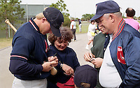 Boston Red Sox Greg Blosser signs autographs during Spring Training circa 1992 at Chain of Lakes Park in Winter Haven, Florida.  (MJA/Four Seam Images)