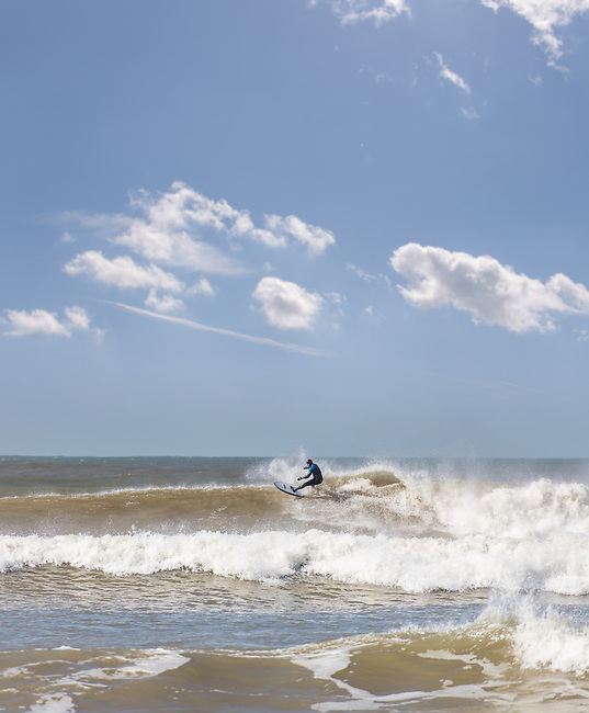 Surfing at Compton Beach on the Isle of Wight.