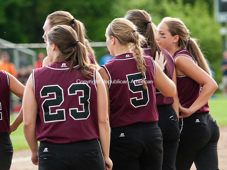 SEYMOUR, CT-30 May 2014-053014EC13-  Torrington walks off the field after losing to Seymour. The Wildcats defeated the Red Raiders, 2-1, to win the NVL softball championship at Woodland Friday. Erin Covey Republican-American