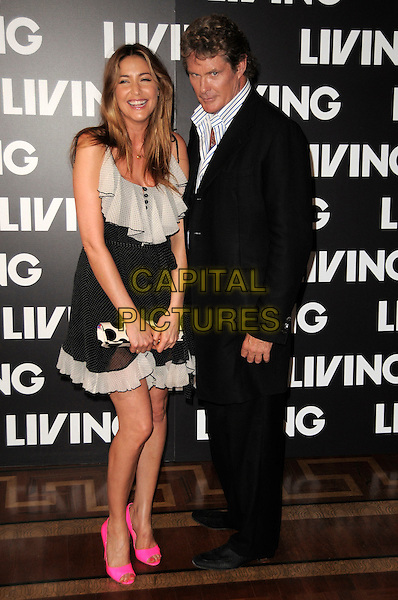 LISA SNOWDON & DAVID HASSELHOFF.Launch Party for Living TV's Summer Schedule at Somerset House, London, USA..July 1st 2009.full length black suit jacket white blue striped stripes shirt trousers pink neon fluorescent shoes white ruffle dress clutch bag polka dot.CAP/CAS.©Bob Cass/Capital Pictures.