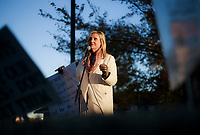 NWA Democrat-Gazette/CHARLIE KAIJO Susan Gleghorn speaks to attendees during a rally, Friday, November 2, 2018 at the Gardens At Osage Terrace in Bentonville. Her mother is a resident of the facility and may lose her ability to reside there.<br />