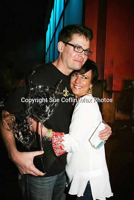 Trent Dawson holds a present given to him by his fans and poses with castmate Colleen Zenk Pinter at his 6th Annual Martinis With Henry on April 17, 2010 at Latitude, New York City, New York. (Photo by Sue Coflin/Max Photos)