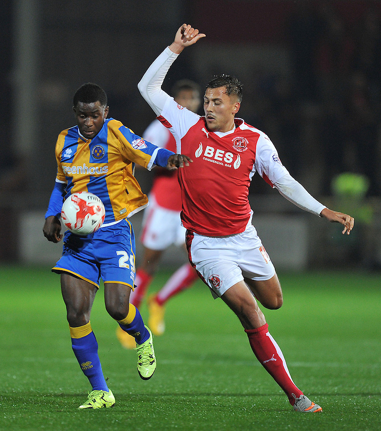 Fleetwood Town's Antoni Sarcevic battles with Shrewsbury Town's Larnell Cole<br /> <br /> Photographer Dave Howarth/CameraSport<br /> <br /> Football - Johnstone's Paint Trophy Northern Section Second Round - Fleetwood Town v Shrewsbury Town - Tuesday 6th October 2015 - Highbury Stadium - Fleetwood<br />  <br /> &copy; CameraSport - 43 Linden Ave. Countesthorpe. Leicester. England. LE8 5PG - Tel: +44 (0) 116 277 4147 - admin@camerasport.com - www.camerasport.com