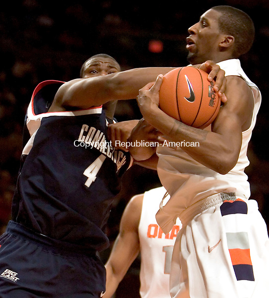 NEW YORK, NY--07 MARCH 2007--030707JS16-UConn's Jeff Adrien battles Syracuse's Demetris Nichols for a rebound during their Big East tournament game Wednesday at Madison Square Garden in New York City. UConn lost 78-65.<br /> Jim Shannon / Republican-American
