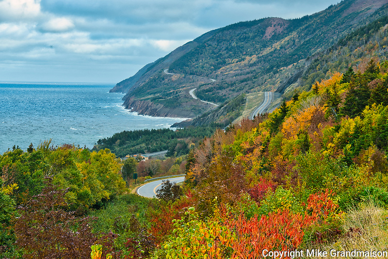The Cabot Trail along the Gulf of St. Lawrence meanders through the Acadian forest in autumn foliage<br />Cape Breton Highlands National Park<br />Nova Scotia<br />Canada