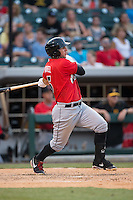 Brent Morel (5) of the Indianapolis Indians follows through on his swing against the Charlotte Knights at BB&T BallPark on June 20, 2015 in Charlotte, North Carolina.  The Knights defeated the Indians 6-5 in 12 innings.  (Brian Westerholt/Four Seam Images)