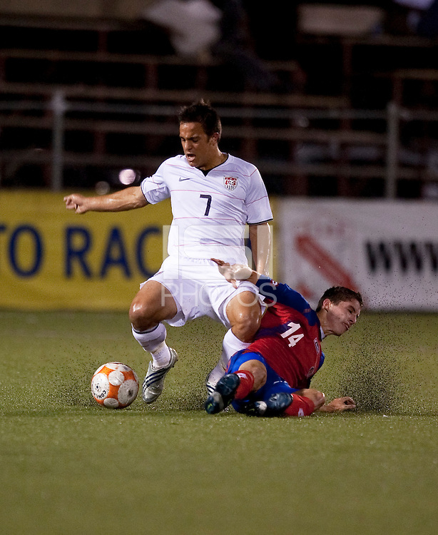 Danny Cruz (7) kicks the ball over Bryan Oviedo (14). Costa Rica defeated the US Under 20 Men's National team 3-0 during the 2009 CONCACAF U-20 Championship game at Marvin Lee Stadium Trinidad & Tobago in Macoya, Trinidad on March 17th, 2009.