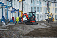 "Pictured: A digger is used to clear debris off the promenade of the seaside town of Aberystwyth, Wales, UK. Monday 23 October 2017<br /> Re: A clean operation is under way at coastal parts of the UK were affected by Storm Brian.<br /> Roads in Aberystwyth's seafront and at nearby Aberaeron, Wales were shut on Saturday morning as a yellow ""be aware"" Met Office warning is in place."