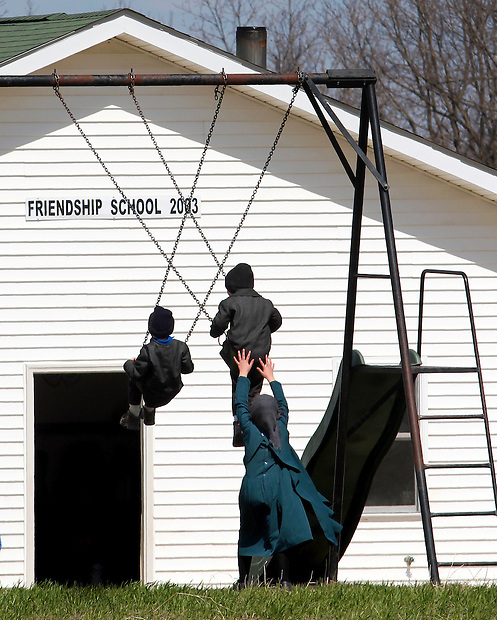 Amish schoolchildren play outside their schoolhouse south of Drakesville in southeast Iowa's Davis County.   It is among only a handful of rural Iowa counties in the 2010 Census to gain population (2.4 percent).  Much of that population growth is due to a steadily growing Amish population.  (Christopher Gannon/The Des Moines Register)