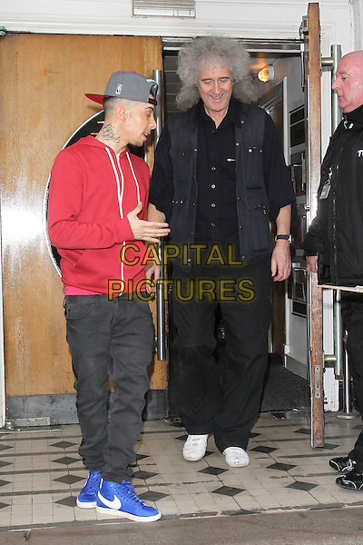 Dappy (Costadinos Contostavlos) and Brian May at the BBC Radio 1's Live Lounge, London, England..February 27th, 2012.full length red top baseball cap hat jeans denim grey gray profile side .CAP/HIL.©John Hillcoat/Capital Pictures .