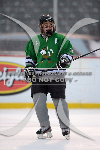 Notre Dame Fighting Irish of Batavia forward Zach Laird (12) during a varsity ice hockey game against the Brockport Blue Devils during the Section V Rivalry portion of the Frozen Frontier outdoor hockey event at Frontier Field on December 22, 2013 in Rochester, New York.  (Copyright Mike Janes Photography)