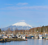 View of Mount Edgecumbe overlooking the New Thomsen harbor in the coastal town of Sitka, Southeast, Alaska