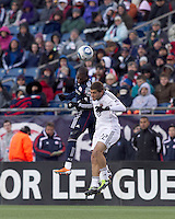 New England Revolution forward Sainey Nyassi (17) and DC United defender Chris Korb (22) battle for head ball. In a Major League Soccer (MLS) match, the New England Revolution defeated DC United, 2-1, at Gillette Stadium on March 26, 2011.