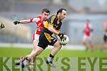 Shane Myers Dr. Crokes in action against Brendan O'Keeffe Rathmore in the Senior Club Championship Final at Fitzgerald Stadium on Saturday Night.