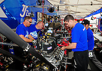 Mar. 10, 2012; Gainesville, FL, USA; NHRA crew members for top fuel dragster driver T.J. Zizzo during qualifying for the Gatornationals at Auto Plus Raceway at Gainesville. Mandatory Credit: Mark J. Rebilas-