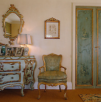 The painted doors and furniture in the bedroom originated in the owner's Venetian palazzo
