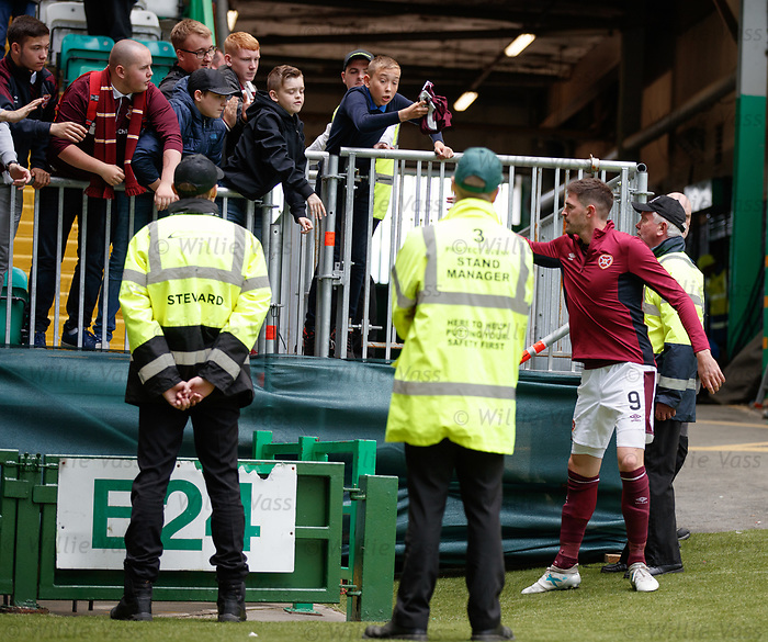 Kyle Lafferty hands his top to the Hearts fans at full time