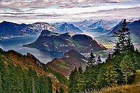 Lake Lucerne surrounded by the Alps and rural countryside viewed from worlds steepest cog train on descent from Pilatus Mountain, near Lucerne, Switzerland
