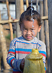 A girl fills a container with water at a community spigot in Makaising, a village in the Gorkha District of Nepal hit hard by a devastating 2015 earthquake.