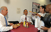 Arlington, VA - May 5, 2009 -- United States President Barack Obama and Vice President Joe Biden receive their cheese burger lunch orders at Ray's Hell Burger in Arlington, Virginia, on May 5, 2009.  .Credit: Roger L. Wollenberg - Pool via CNP