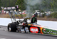 Mar 15, 2014; Gainesville, FL, USA; NHRA top fuel dragster driver Terry McMillen climbs from his car after exploding an engine and tire during qualifying for the Gatornationals at Gainesville Raceway Mandatory Credit: Mark J. Rebilas-USA TODAY Sports