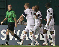 Players of Real Salt Lake follow referee Mark Kadlecik after he had awarded a penalty kick to D.C. United during an Open Cup match against D.C. United at RFK Stadium, on June 2 2010 in Washington DC. DC United won 2-1.