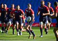 George Ford of England passes the ball. England Captain's Run on October 9, 2015 at Manchester City Stadium in Manchester, England. Photo by: Patrick Khachfe / Onside Images