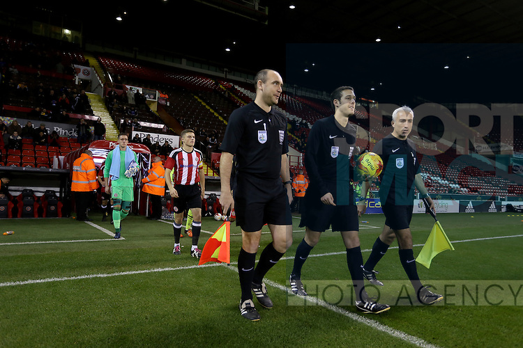 match officials lead out the teams during the FA Youth Cup First Round match at Bramall Lane Stadium, Sheffield. Picture date: November 1st 2016. Pic Richard Sellers/Sportimage