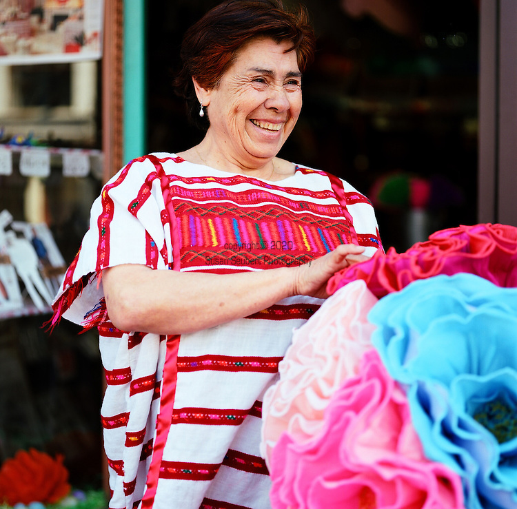 Casa Bonampak is a shop in the heart of the Mission's Latin district specializing in Fair Trade items and socially responsible gifts.  Artist Herminia Albarrau is pictured here with some paper flowers similar to the ones she creates that are occasionally available at the store.