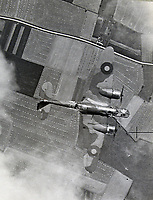 BNPS.co.uk (01202 558833)<br /> Pic:  Tooveys/BNPS<br /> <br /> Taken on 18/08/41 -  A camouflaged Blenheim Mark VI during a daytime attack on Lille.<br /> <br /> Dramatic photos showing a series of heart-pounding World War Two bombing raids from the pilot's perspective have come to light.<br /> <br /> They were taken from Blenheim bombers undertaking attacks on targets in Germany and Nazi-occupied Netherlands in 1941.<br /> <br /> Several capture the immediate aftermath of a direct hit, with flames and clouds of smoke signifying they had achieved their aim.<br /> <br /> The album, which contains almost 100 photos, has emerged for sale with Toovey's Auctions, of Washington, west Sussex.