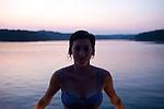 Amber Fouts, Berny Weber, David Banks and friends at Lake Lanier in Georgia at dusk.