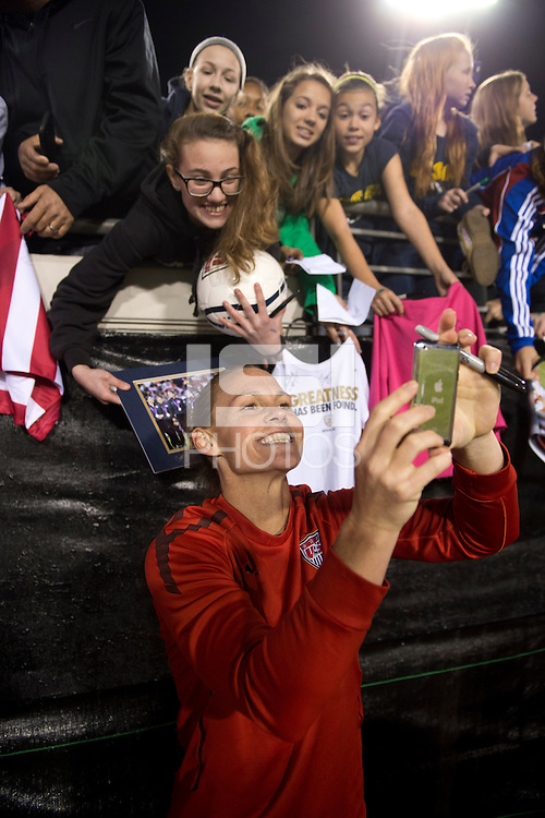 Christie Rampone (3) of the USWNT takes a photo with fans after the game during the game at EverBank Field in Jacksonville, Florida.  The USWNT defeated Scotland, 4-1.