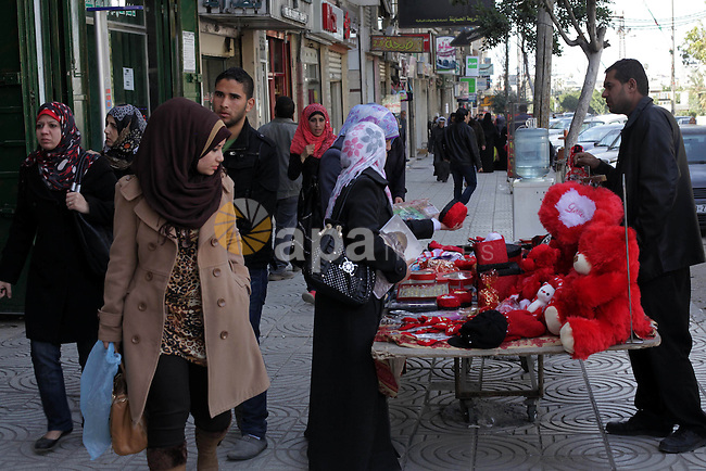 Palestinians shop for themed gifts ahead of Valentine's Day in Gaza city, on February 13, 2013. Valentine's Day, celebrated on February 14, is named after the Christian patron saint for lovers. Photo by Ashraf Amra